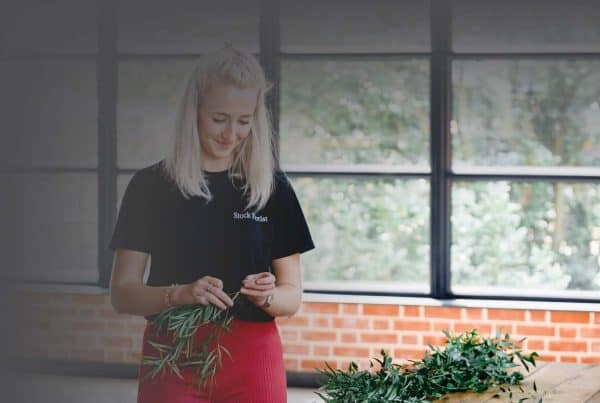 Lady arranging flowers in Essex